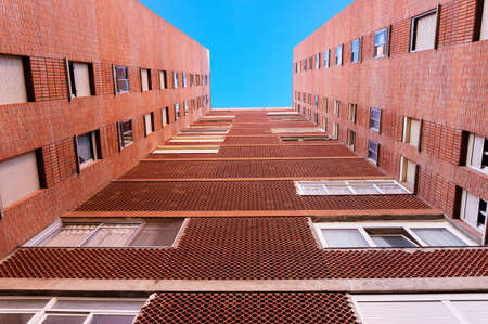 Block of council flats. Low viewpoint perspective. Stock Photo - 24641820