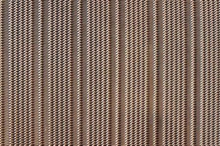 Perforated metal macro shot for background or texture photo