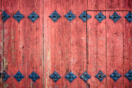 Old wooden door with hardware detail for Backgroun or Texture photo