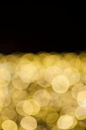 Yellow lights bokeh background with black copy space