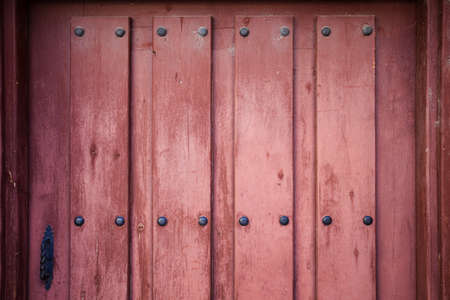 Old wooden door with hardware detail for Backgroun or Texture Stock Photo
