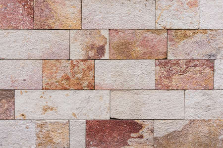 Colored stone wall detail for backgrounds or texture