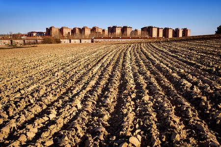Crop plowed fields near a city  Valladolid, Spain