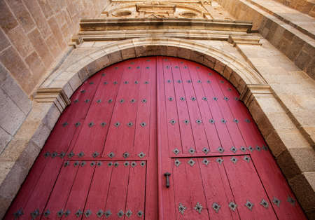 Beautiful door of a Spanish ancient church. Personal perspective.