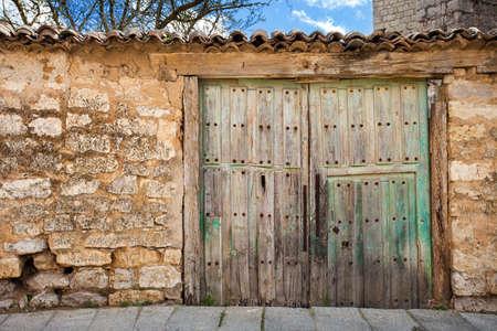 Old Patio front wooden door shut. Valladolid, Spain.
