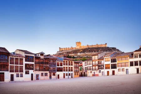 singular architecture: Small town of Penafiel with Castle and Old Square used for bull fights. Valladolid, Spain. Editorial