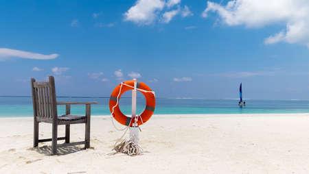 Lifebuoy on the tropical beach - Maldives