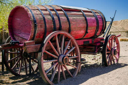 Old wooden cart with water tank
