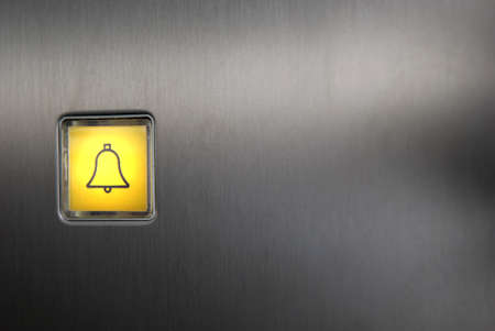 emergency button: Luminescent panic button of an elevator.