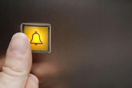 Pushing the illuminated panic button in an elevator. Standard-Bild