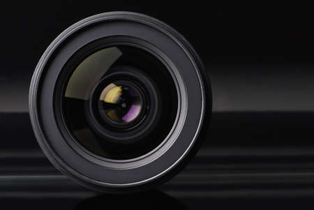 objective with lens reflections on black background