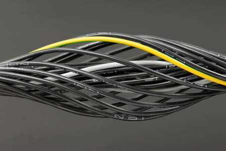 Some black numbered cables with one grounding cable. 版權商用圖片