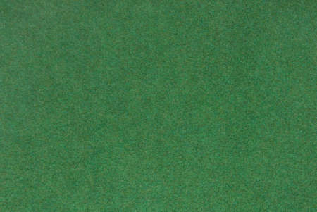 factitious: Synthetic turf for use as background.