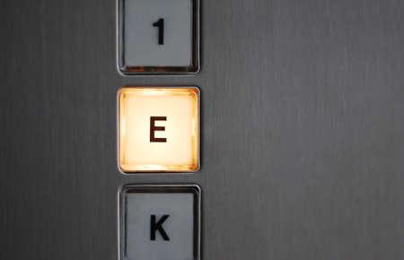 Illuminated basement button in an elevator. Standard-Bild