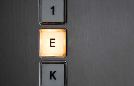 special steel: Illuminated basement button in an elevator. Stock Photo