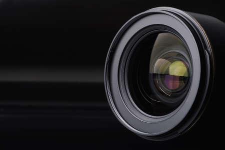 Ziel mit Objektiv Reflexionen auf schwarzem Hintergrund