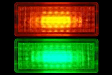 telltale: Macro detail of a glowing red and green control lamp. Stock Photo