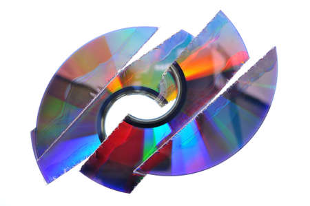 dvds: From a shredder destroyed CD. Important for data privacy. Stock Photo