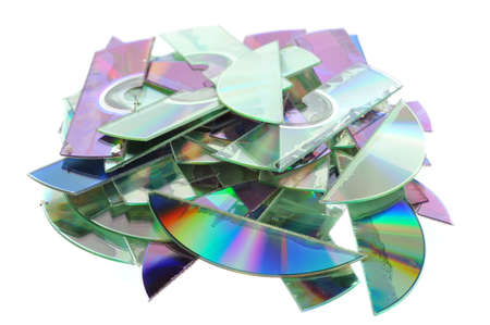 Destroyed CDs - shredded by a shredder.  版權商用圖片