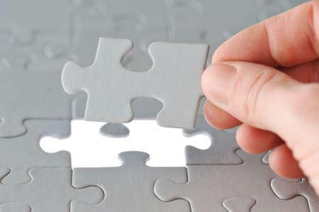 Das letzte Stück ein Puzzle-Spiel. Lizenzfreie Bilder