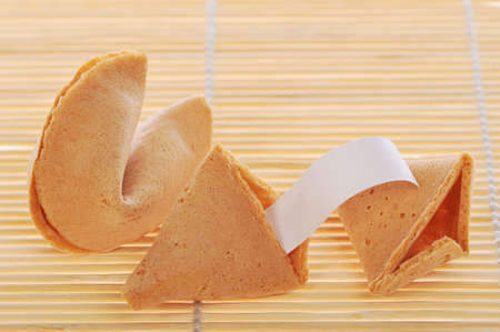 Two fortune cookies with text banner on rattan background. Stock Photo - 4467200