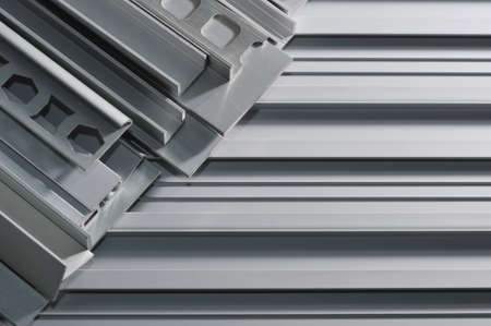 many different aluminum sectional strips in spotlight