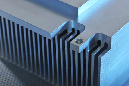 routed: Stylized industrial - showing detail of an CNC manufactured aluminum cooling plate Stock Photo