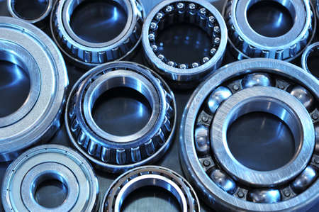 closeup view of several ball-bearings in blue light