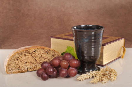 Bread, wine and bible for sacrament or communion photo