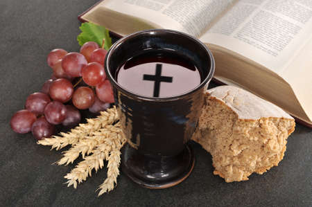easter cross: Bread, wine and bible for sacrament or communion Stock Photo