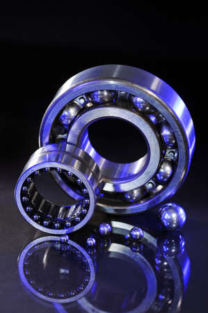 gyration: closeup view of several ball-bearings in UV-light