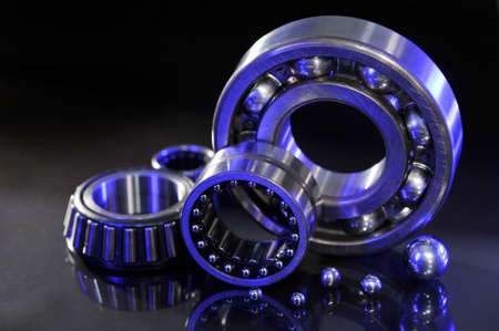 heavy industry: closeup view of several ball-bearings in UV-light