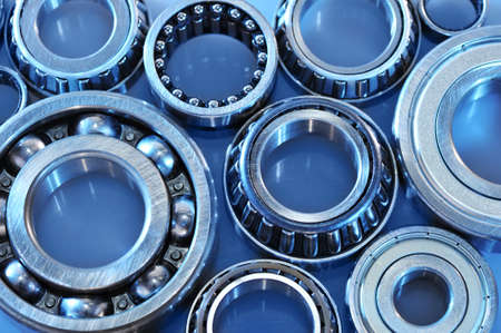 gyration: closeup view of several ball-bearings in blue light