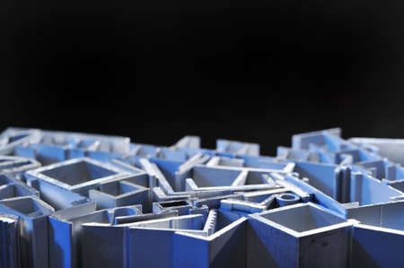 routed: many different aluminum sectional strips in blue spotlight