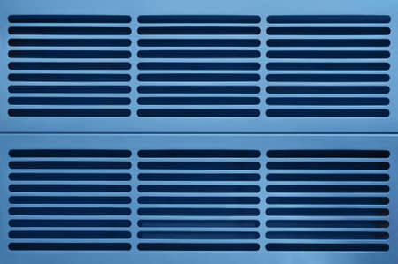 routed: abstract industry background made of aluminum ventilation grids in blue light
