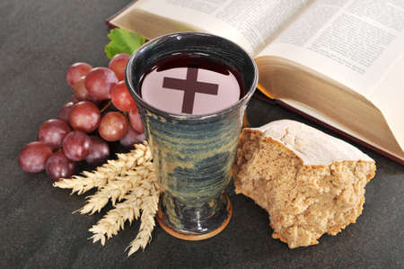 Bread, wine and bible for sacrament or communion Stock Photo