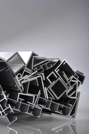 routed: many different aluminum sectional strips in spotlight