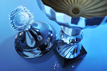 adroitness: detail of a chromed trophy in exceptionally light