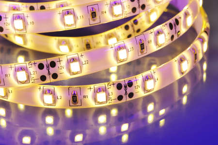 macro detail of a warmwhite LED-stripe in colored spotlight