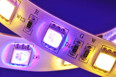 macro detail of a RGBW-LED-stripe with warmwhite LEDs in colored spotlight
