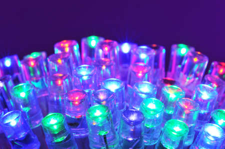 macro detail of some colored LEDs in purple spotlight Stock Photo