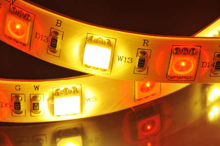 macro detail of a RGB-LED-stripe combined with warmwhite LEDs in colored spotlight Stock Photo
