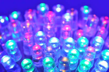 macro detail of some colored LEDs in blue spotlight