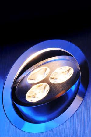 macro detail of a warmwhite triple-LED in blue spotlight
