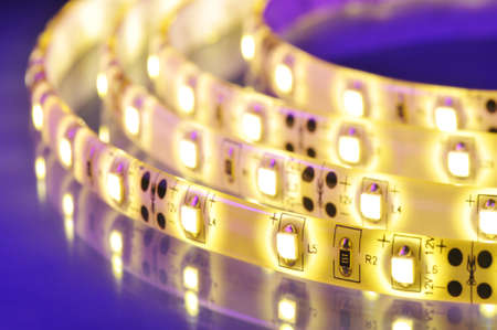 macro detail of a warmwhite LED-stripe in colored spotlight photo