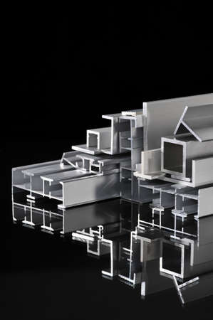 routed: many different aluminum sectional strips with reflection Stock Photo