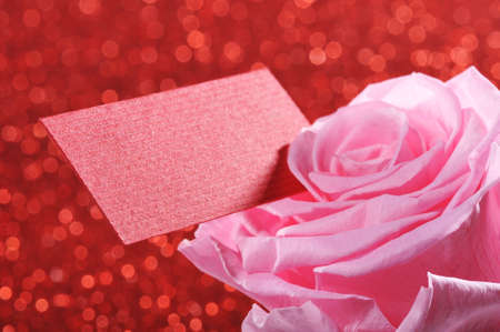 mother'sday: Pink rose with red greeting card on red sparkle background