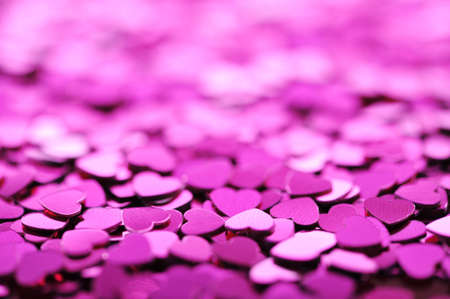 mother'sday: close-up view of many small pink glitter hearts