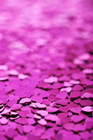 cordiality: close-up view of many small pink glitter hearts