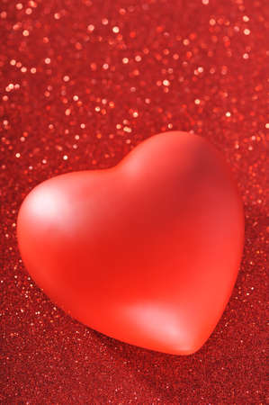cordiality: Red heart on red sparkle background